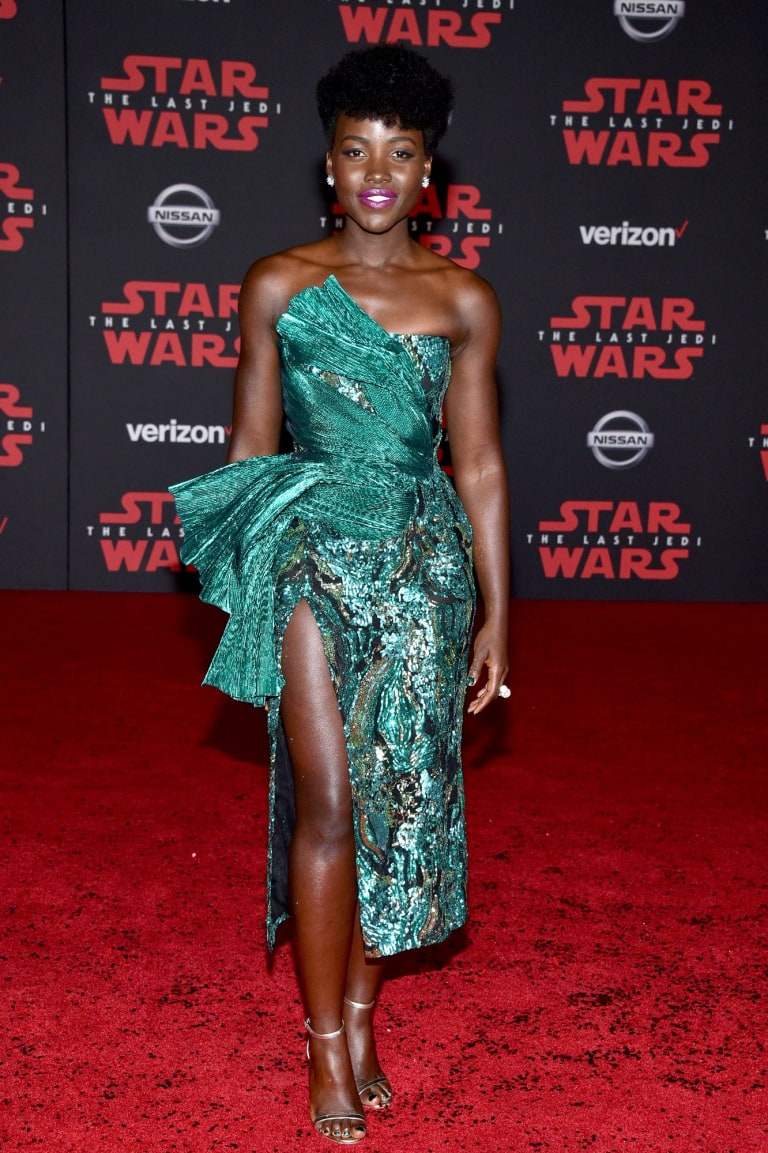 Bold sparkle in jewelled tones, as seen on Lupita Nyong'o, is shaping as the hottest red carpet trend of the moment.