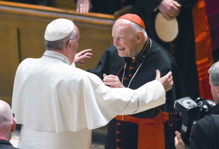 Pope Francis reaches out to hug Cardinal Archbishop emeritus Theodore McCarrick in 2015 before the scandal broke.