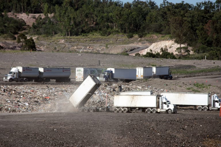 Unprocessed waste from Cleanaway's Willawong recycling facility in south Brisbane is dumped at the company's New Chum landfill in Ipswich.