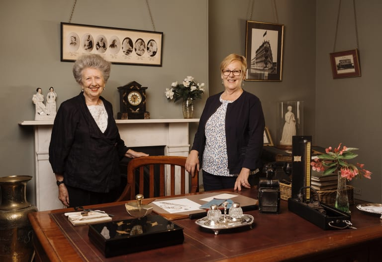 Elinor Wrobel, curator of Sydney's Lucy Osburn-Nightingale Museum,  and Marilyn Gendek, an expert on the history of Australian nursing, at Osburn's desk in the museum.