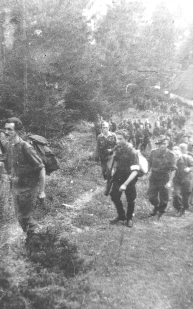 A picture of the escape march through Slovenia given to Ralph Churches years later by Karol Cholnik, latterly of Bacchus Marsh in Melbourne. Churches can be seen wearing his slouch hat and Cholnik is leading the column.