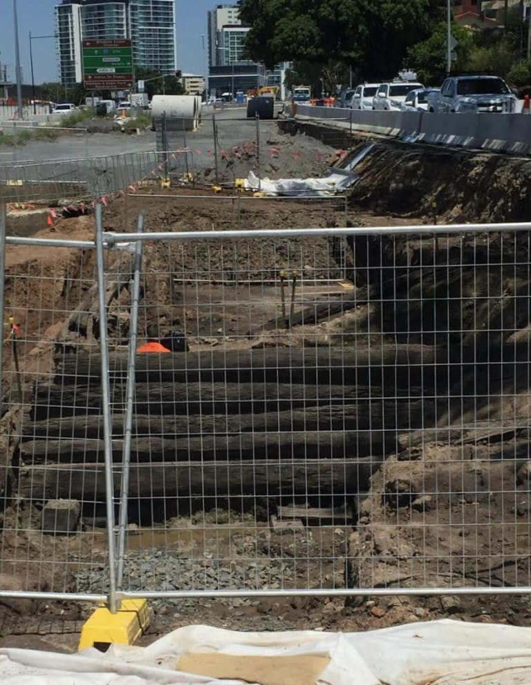 A pre-1860s timber bridge has been unearthed under Kingsford Smith Drive near Nudgee Road.