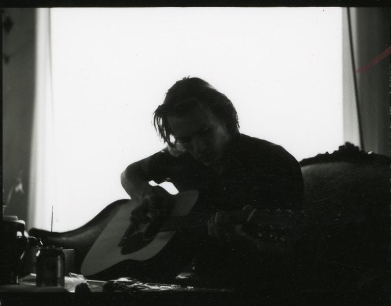 Heath playing guitar, c2002,