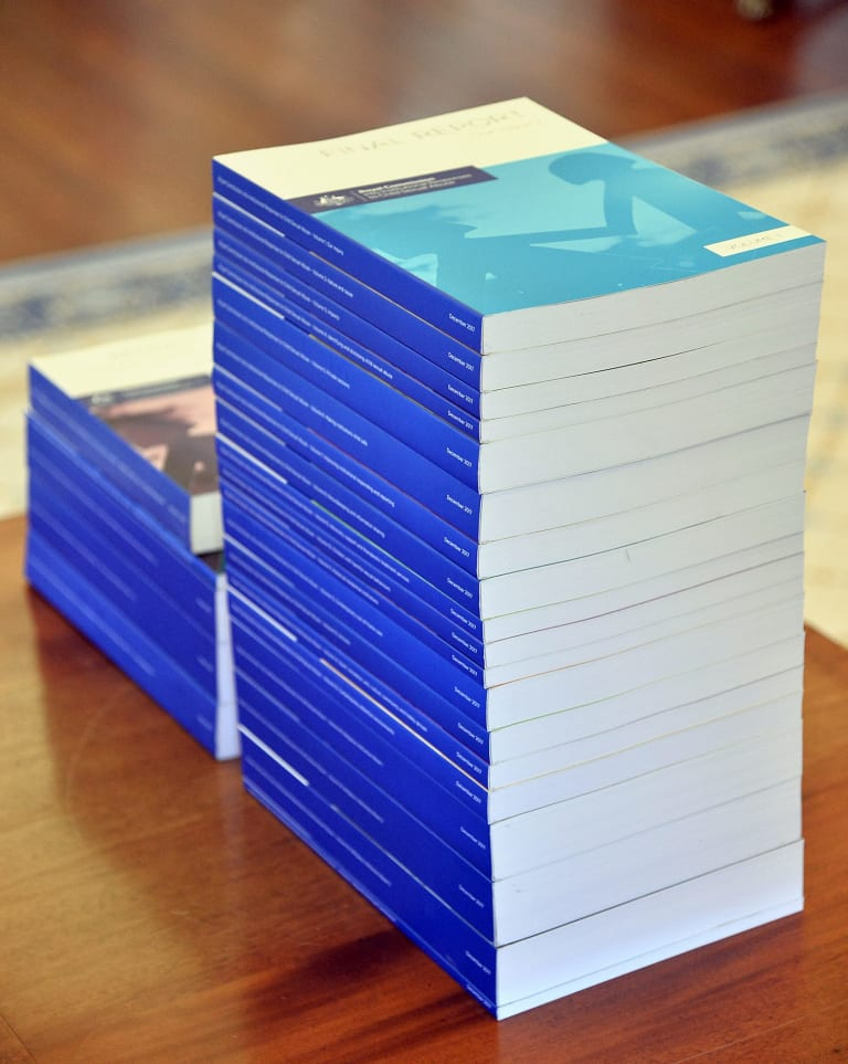 The 17 volumes of the royal commission's final report.