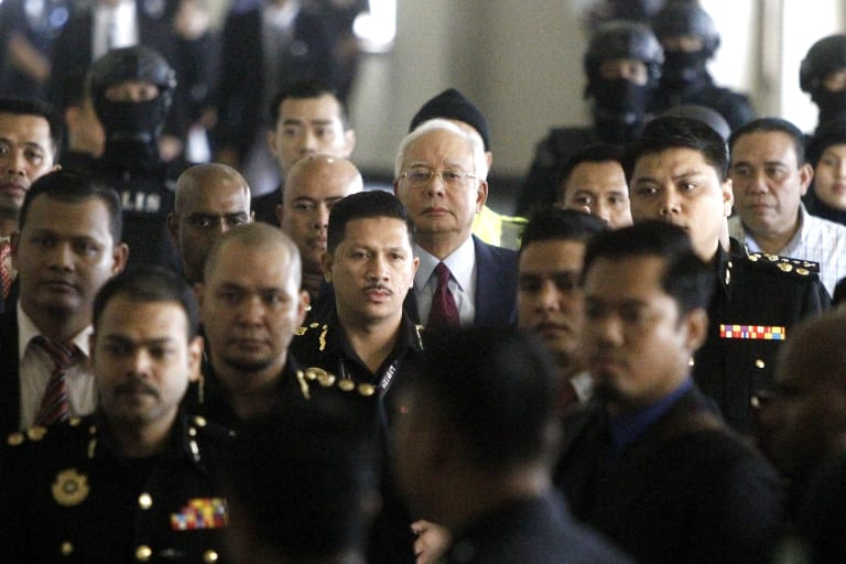 Najib Razak walks into a courtroom in Kuala Lumpur, Malaysia where he was charged with corruption offences.
