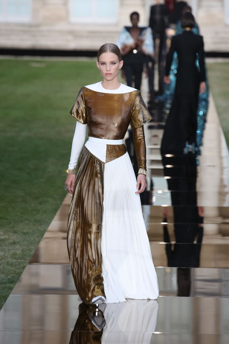 A model wears a dress by Givenchy during couture week on Sunday.