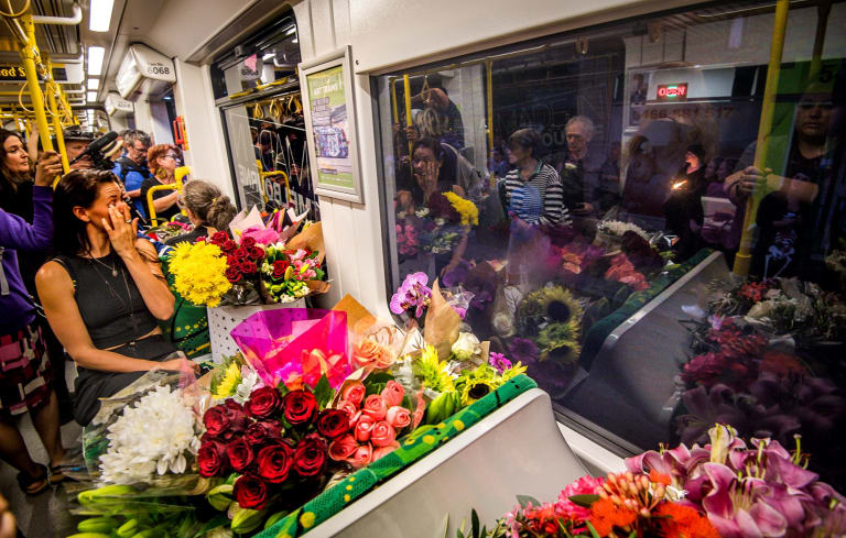 The Age, News, 18/01/2019. Photo by Justin McManus. Vigil at Parliament House for murdered student Aiia Maasarwe. Mourners bring flowers at stops on 86 tram to be delivered to the scene of the murder in Bundoora for a vigil.