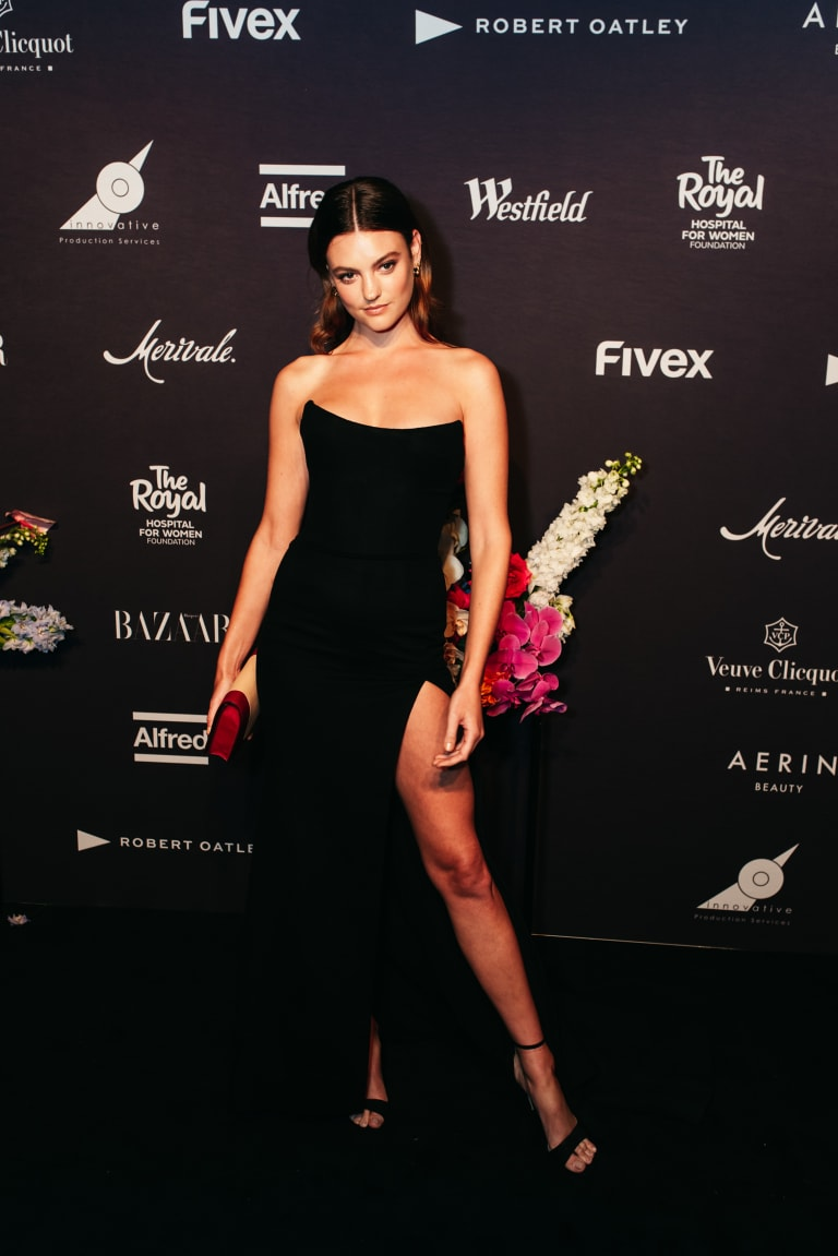 Strike a pose: Montana Cox at the Harpers Bazaar In Bloom event, keeping her distance from Justin Hemmes.