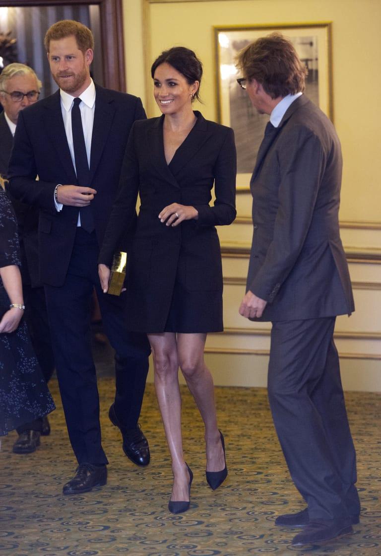 Meghan, Duchess of Sussex, in a tuxedo dress.