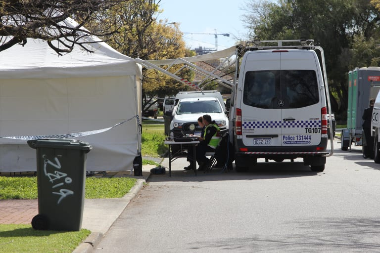 A police forensic tent set up in the driveway of the Carlisle property on Wednesday.