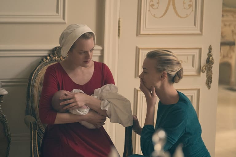 Offred the handmaid, played by Elizabeth Moss, and commander's wife Serena Joy, played by Yvonne Strahovski.