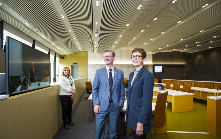 Chief Justice, Helen Murrell shows attorney general, Gordon Ramsay around the new court room's advanced technology. Pictured with in court technology officer, Drani Sarkozi.