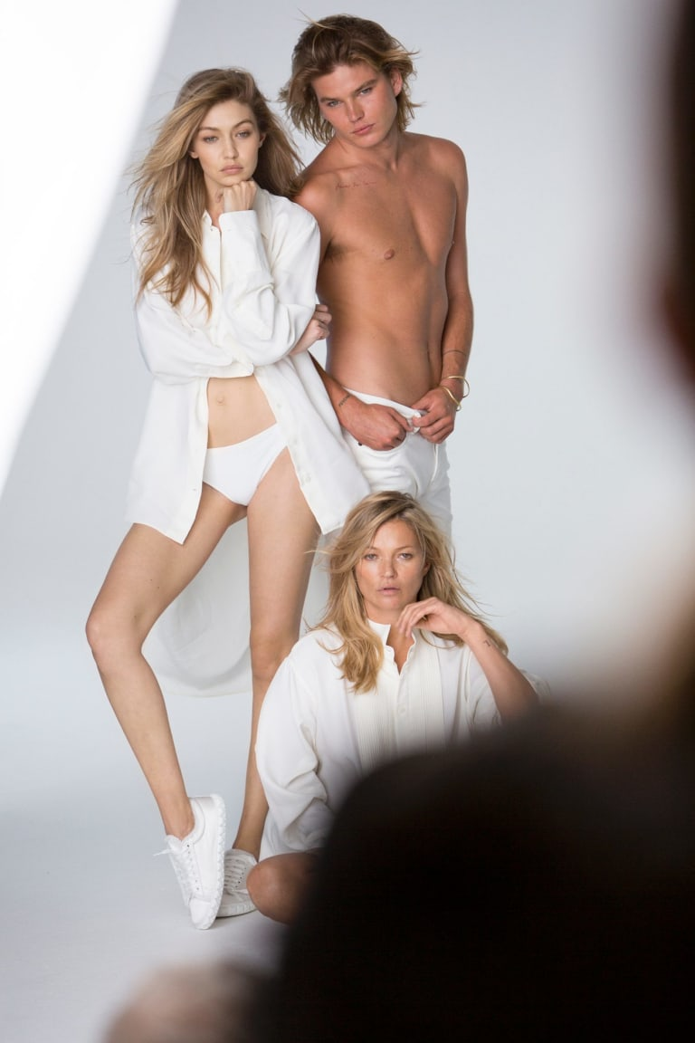 A behind-the-scenes photo featuring (from left) Gigi Hadid, Jordan Barrett and Kate Moss from the most recent Stuart Weitzmann campaign.