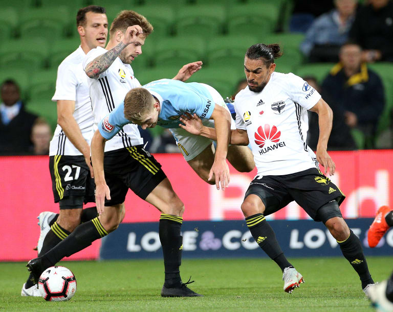Let me at it: Melbourne City's Riley McGree fights for the ball last night.