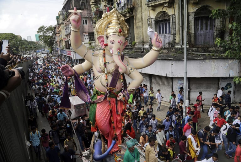 A giant statue of the god Ganesha  is paraded through the streets of Mumbai.