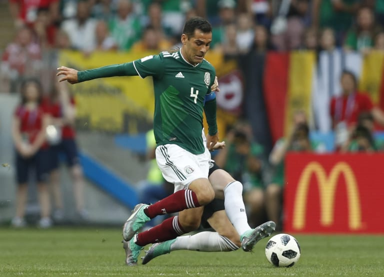 Mexico's Rafael Marquez clashes with Germany's Marco Reus during the World Cup match between Germany and Mexico in Moscow.