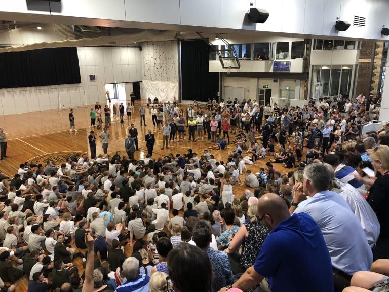 Trinity Grammar headmaster Michael Davies addresses the school community at an emergency meeting on Friday.
