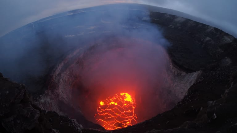 A wide-angle camera view captures the entire north portion of the Overlook crater on May 6 as Hawaii's Kilauea volcano erupts.