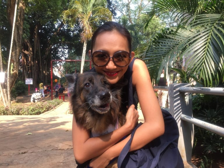 A member ofthe Dog Meat-Free Indonesia coalition with a rescued dog.