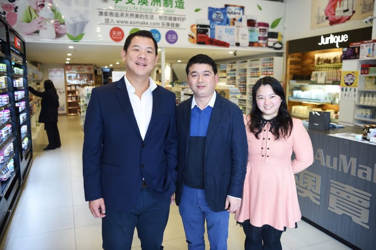 """""""We are pre-daigou really, we have been sending these kinds of products to China since 2010,"""" says Mr Zhou (middle)."""