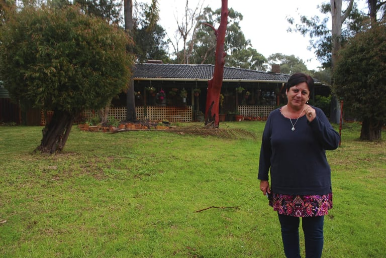 Eva Ricci outside her old home in Wattleup. She moved from the home 11 years ago, and she observed members of her own family and many neighbours suffer with their health.