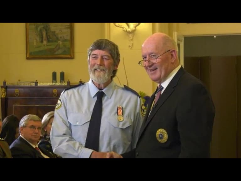 "Graeme ""Duck"" Tonge, pictured left, receives a long service award to ACT SES from Govenor General Peter Cosgrove"
