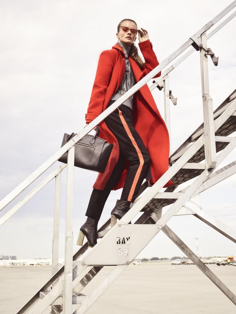 """Sportmax """"Cassino"""" coat, $4420, and """"Hudson"""" knit top, $1065. Sandro Paris pants, $395. Bally bag, $1450. Salvatore Ferragamo boots, $1790. Le Specs """"Fugitive"""" sunglasses, $119."""