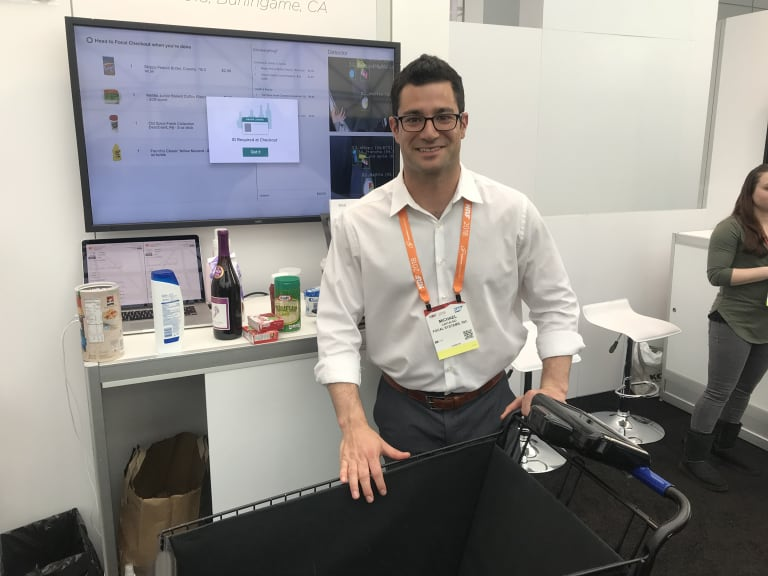 Michael Cantalino from Focal Systems with the company's automated trolley.