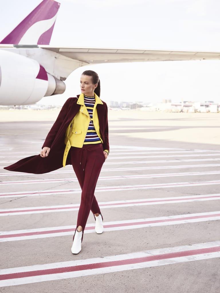 """Cos coat, $450. Zara jacket, $99, and top, $50. Camilla and Marc """"Blake"""" pants, $170. Bally bag, $825."""