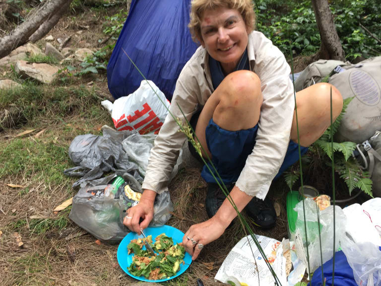 Francisca Boterhoven De Haan has a meal at a campsite she and William McCarthy set up during their six nights in Morton National Park.