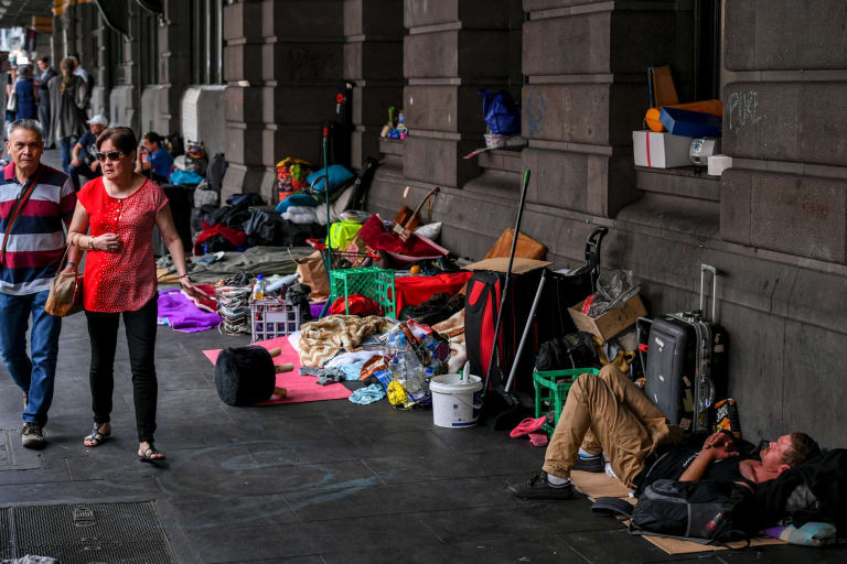 A large homeless camp outside Flinders Street Station in Melbourne.