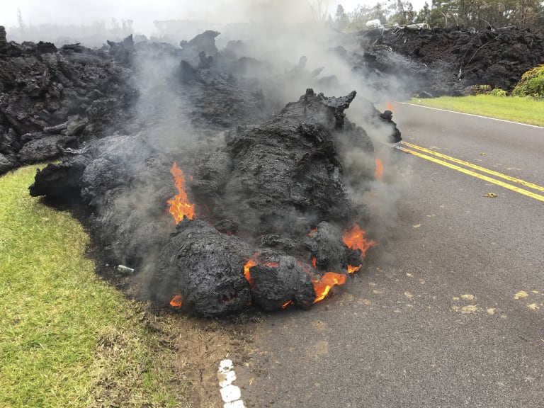 Lava from the Kilauea volcano moves across the road in the Leilani Estates in Pahoa, Hawaii, on May 5.