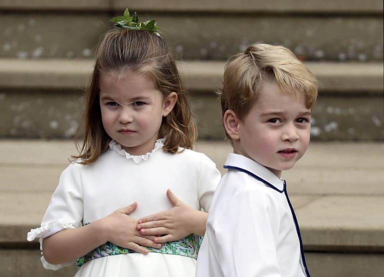 Prince George and Princess Charlotte arrive for the royal wedding.