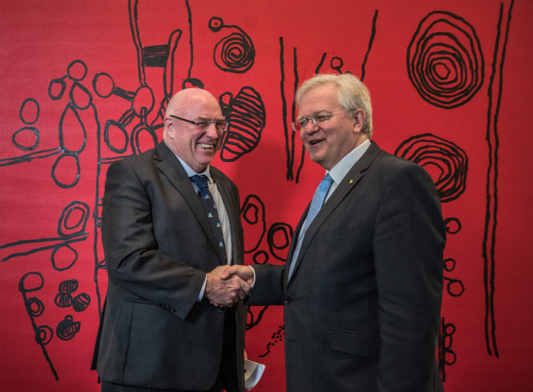 Canberra lawyer Craig Edwards with ANU vice-chancellor Brian Schmidt in front of one of the works Mr Edwards has just donated to the university.