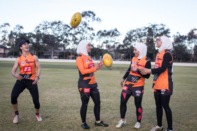 Auburn Giants AFL team (left to right) Captain of the Premier division women's league, Hayat Ajaj, with team members Amna Karra-Hassan, Liali Karra-Hassam and Lael Kassem.