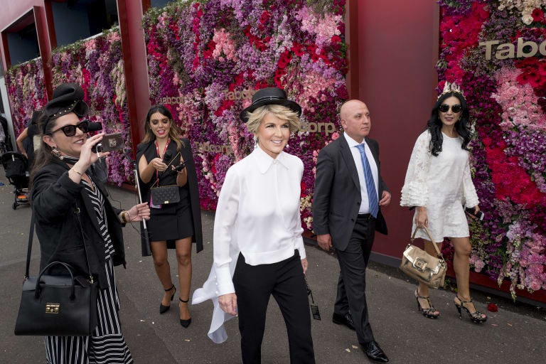 Packing black: Former foreign minister Julie Bishop makes her way to the Birdcage.