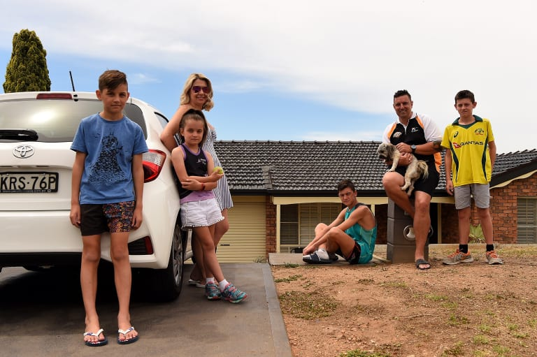 The Haywood family in front of their Erskine Park home. (From left to right) Ryan Haywood, 11, Keeley Haywood, 8, Kristy Haywood, 41, Lachlan Haywood, 15 and Cameron Haywood, 40, holding Tigah, and Joel Haywood, 13.