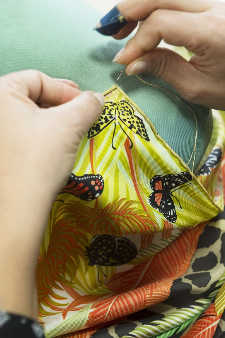 An artisan works on a silk scarf, one of the disciplines on show at the Hermes at Work exhibition.
