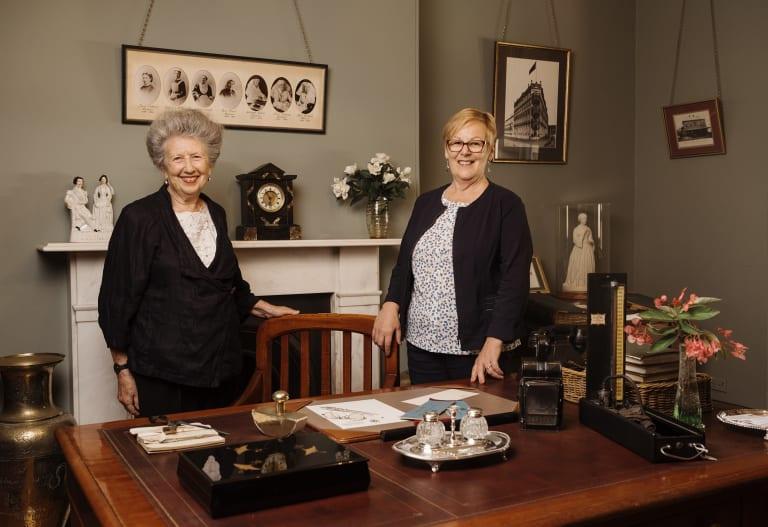 Elinor Wrobel, curator of Sydney's Lucy Osburn-Nightingale Museum,  and Marilyn Gendek, an expert on the history of Australian nursing, at Osburn's desk in the museum.