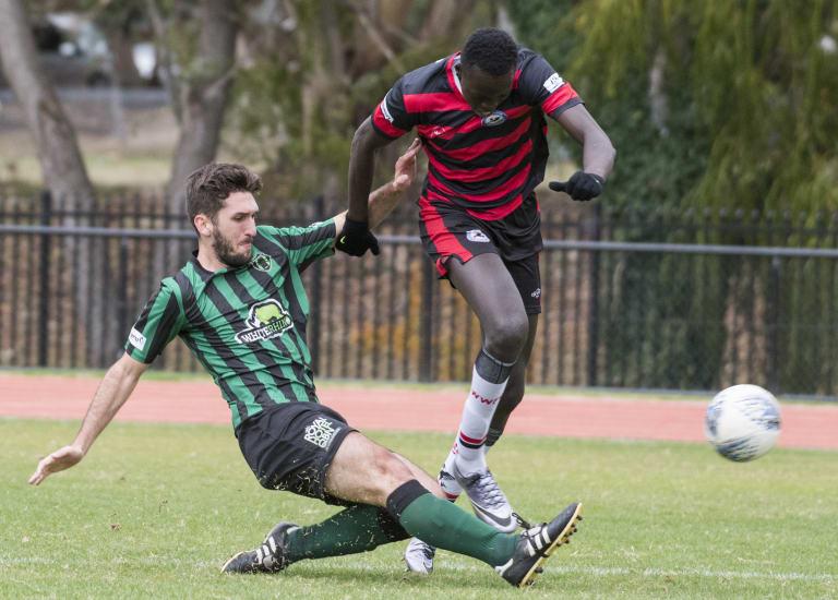 Monaro Panthers player Ole Stegavik tackles the ball from Woden-Weston's Deng Deng.