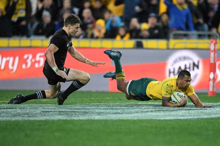Kurtley Beale of Australia scores a try.