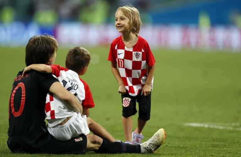 Family affair: Croatia's Luka Modric celebrates after winning the quarter-final.