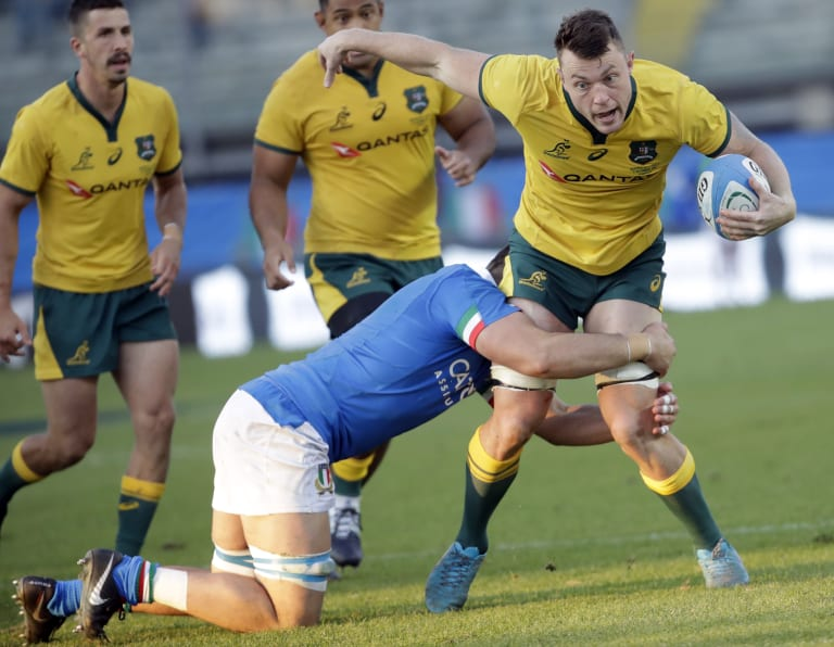 Australia's Jack Dempsey, right, is tackled by Italy's Jake Polledrid.