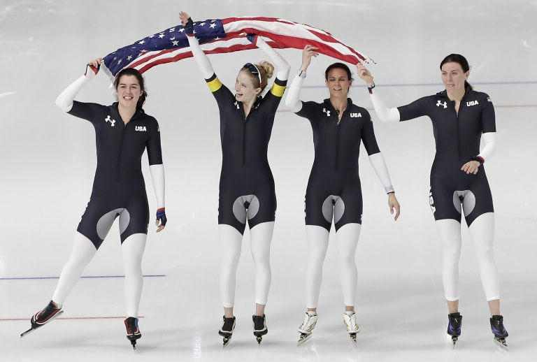 Heather Bergsma, Mia Manganello, Brittany Bowe and Carlijn Schoutens celebrate their bronze medal in the Women's Speed Skating Team Pursuit final B competition at the Gangneung Oval during the PyeongChang 2018 Olympic Games.