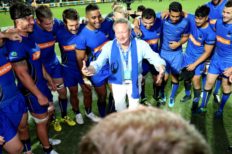 Andrew 'Twiggy' Forrest celebrates with the Force after the match.