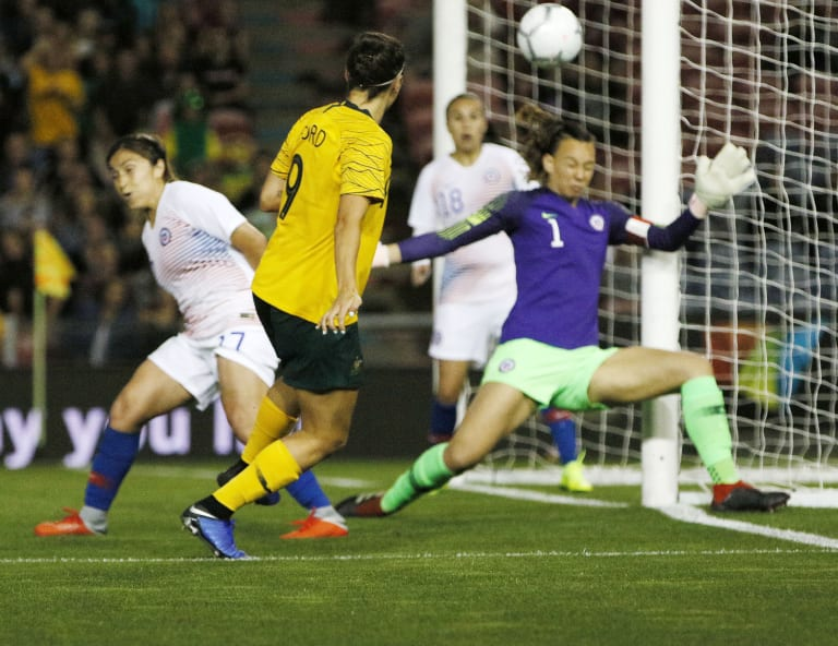 Caitlin Foord slots home Australia's second from an acute angle.