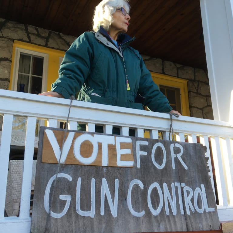 Rose Cathleen Bagin stands on the porch of her home in the Squirrel Hill district of Pittsburgh.