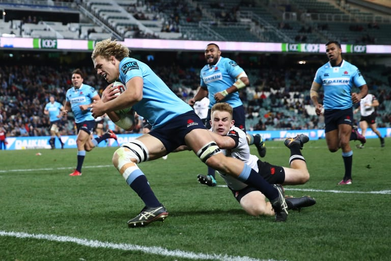 Finals-bound: Nad Hanigan crosses in the Waratahs' record win over the Sunwolves.