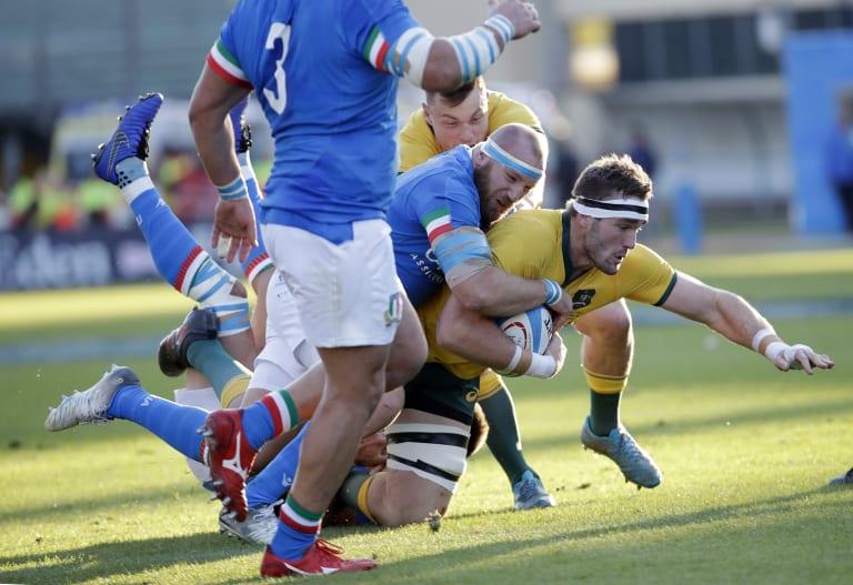 Izack Rodda, right, is tackled by Italy's Leonardo Ghiraldini.
