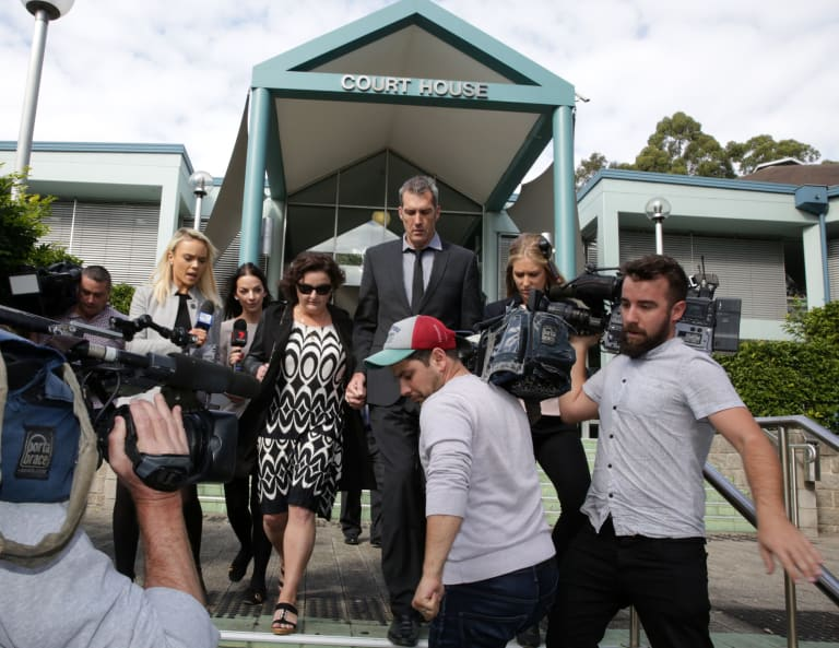 Julie Goodwin and her husband, Mick, run the media gauntlet after she was convicted of drink driving charges in Gosford last week.